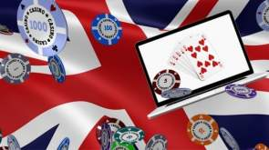 UK flag background with laptop casino - chips and cards